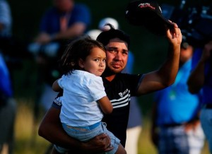 SHEBOYGAN, WI - AUGUST 16: Jason Day of Australia walks off the 18th green with his son Dash after winning the 2015 PGA Championship with a score of 20-under par at Whistling Straits on August 16, 2015 in Sheboygan, Wisconsin.   Kevin C. Cox, Image: 255756839, License: Rights-managed, Restrictions: , Model Release: no, Credit line: Profimedia, AFP
