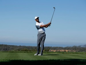 February 5, 2015: Tiger Woods follow through after a tee shot during the first round of the Farmers Insurance Open at Torrey Pines in La Jolla, CA., Image: 217527982, License: Rights-managed, Restrictions: Content available for editorial use, pre-approval required for all other uses., Model Release: no, Credit line: Profimedia, Corbis