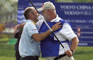 Markus Brier (L) of Austria is congratulated by his caddie Max Zechmann on the 18th green after winning the Volvo China Open at the Silport Golf Club in Shanghai, 15 April 2007. Brier blazed a final-round 67 to claim the 2 million USD Volvo China Open, which is co-sanctioned between the European and Asian Tours, by five shots ahead of Northern Ireland's Graeme McDowell, Australian Scott Hend and Andrew McLardy of South Africa. RESTRICTED TO EDITORIAL USE, Image: 20861599, License: Rights-managed, Restrictions: RESTRICTED TO EDITORIAL USE, Model Release: no, Credit line: Profimedia, AFP